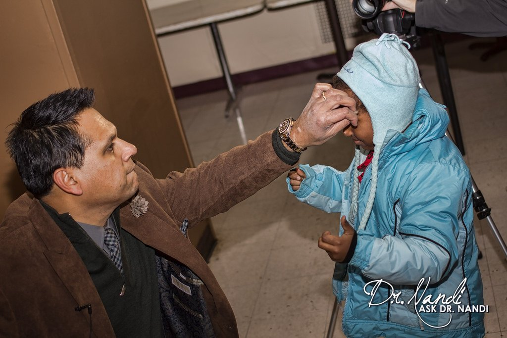 Dr. Nandi Helping Families Find Coats