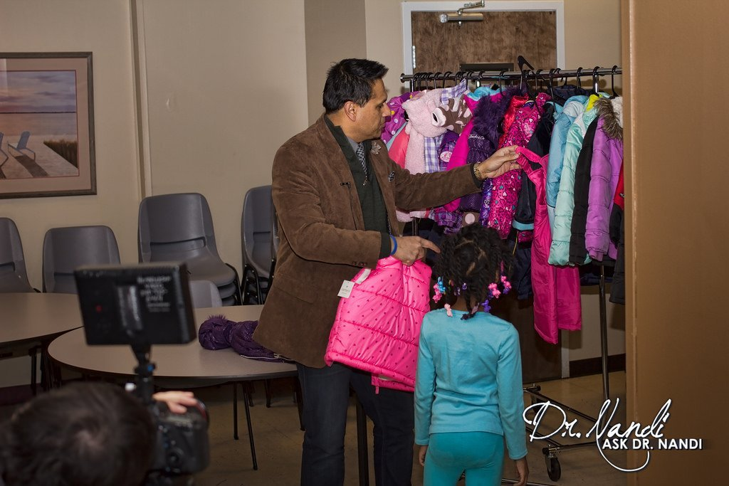 Dr. Nandi Shops Coats with Families