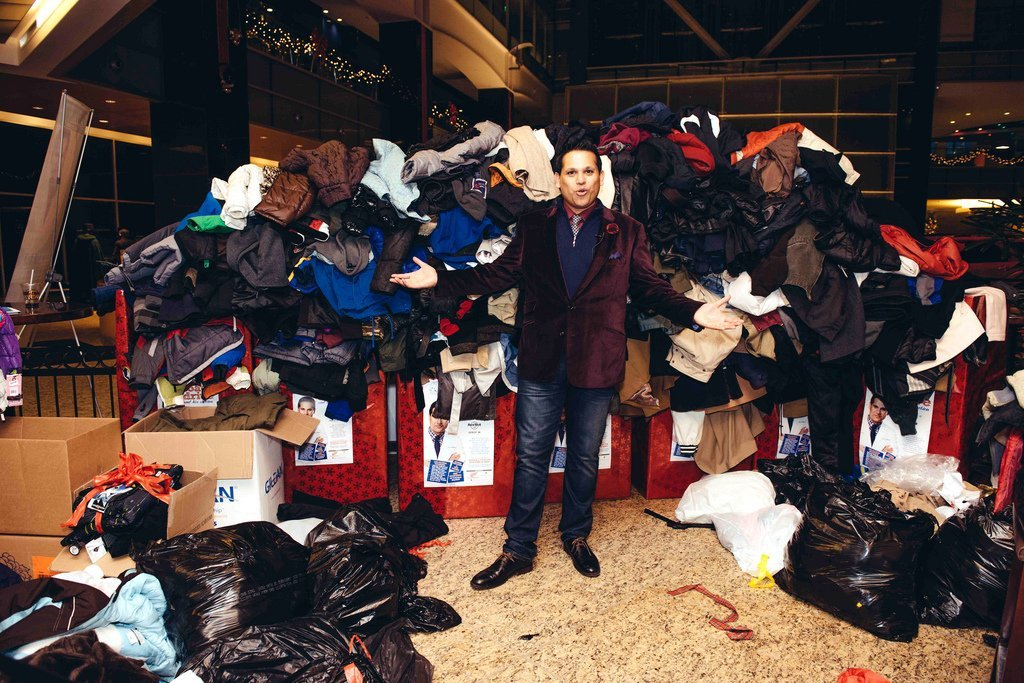 Dr. Nandi with a pile of coats